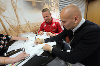 Pictured: Lee Trundle and Jonjo Shelvey sign autographs Wednesday 25 November 2015<br />