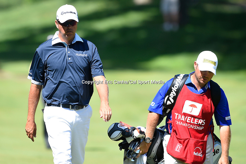 June 22, 2014 - Cromwell, Connecticut - Bo Van Pelt walks down the 10th fairway during the final round of the PGA Travelers Championship tournament held at TPC River Highlands in Cromwell, Connecticut.  Eric Canha/CSM