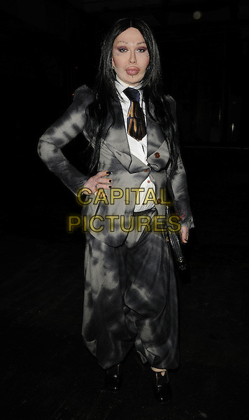 PETE BURNS.The Unconditional s/s/ 2011 fashion show, London Fashion Week, Day 3, Old Sorting Office, London, England..September 19th, 2010.LFW full length black grey gray plastic surgery jacket white shirt harem tie hand on hip.CAP/CAN.©Can Nguyen/Capital Pictures.