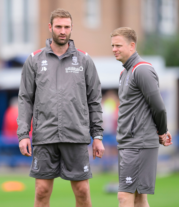 Lincoln City's first team coach/under 23 manager Jamie McCombe, left, and Lincoln City's professional development phase lead Tom Shaw during the pre-match warm-up<br /> <br /> Photographer Chris Vaughan/CameraSport<br /> <br /> Football Pre-Season Friendly (Community Festival of Lincolnshire) - Lincoln City v Lincoln United - Saturday 6th July 2019 - The Martin & Co Arena - Gainsborough<br /> <br /> World Copyright © 2018 CameraSport. All rights reserved. 43 Linden Ave. Countesthorpe. Leicester. England. LE8 5PG - Tel: +44 (0) 116 277 4147 - admin@camerasport.com - www.camerasport.com