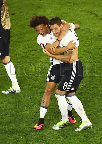 Germany's Leroy Sane and Mesut Oezil celebrates after the UEFA EURO 2016 quarter final soccer match between Germany and Italy at the Stade de Bordeaux in Bordeaux, France, 02 July 2016.