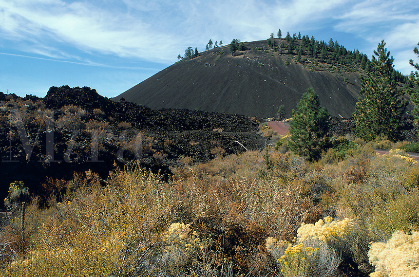 Lava Butte, a 500 foot cinder cone, with lava field in foreground. Bend, Oregon