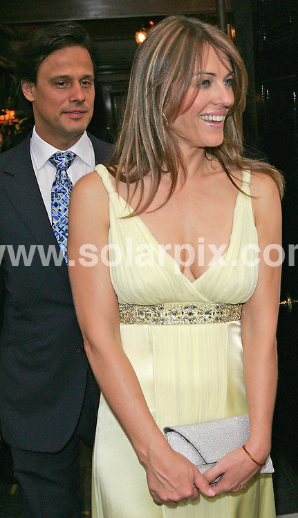**ALL ROUND PICTURES FROM SOLARPIX.COM**.**WORLDWIDE SYNDICATION RIGHTS**.Liz Hurley and Arun Nayer attend the launch of Derby Festival 2007 Magazine at Crockfords in Mayfair, London..JOB REF: 3995    SSD     DATE: 24/05/07.**MUST CREDIT SOLARPIX.COM OR DOUBLE FEE WILL BE CHARGED* *UNDER NO CIRCUMSTANCES IS THIS IMAGE TO BE REPRODUCED FOR ANY ONLINE EDITION WITHOUT PRIOR PERMISSION*