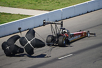 Sept. 29, 2012; Madison, IL, USA: NHRA top fuel dragster driver Luigi Novelli during qualifying for the Midwest Nationals at Gateway Motorsports Park. Mandatory Credit: Mark J. Rebilas-