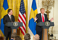 United States President Donald J. Trump and  Prime Minister Stefan Lofven of Sweden hold a joint press conference in the East Room of the White House in Washington, DC on Tuesday, March 6, 2018.<br /> CAP/MPI/RS<br /> &copy;RS/MPI/Capital Pictures