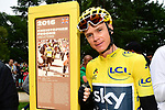 Yellow Jersey Chris Froome (GBR) Team Sky stands beside the newly unveiled sign dedicated to his 2016 Tour victory before Stage 12 of the 104th edition of the Tour de France 2017, running 214.5km from Pau to Peyragudes, France. 13th July 2017.<br /> Picture: ASO/Alex Broadway | Cyclefile<br /> <br /> <br /> All photos usage must carry mandatory copyright credit (&copy; Cyclefile | ASO/Alex Broadway)