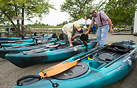 NWA Democrat-Gazette/BEN GOFF @NWABENGOFF<br /> Jimmy Davis (left) of Rogers and Robert Bowers of Grove, Okla., both veterans, set up kayaks while volunteering Saturday, Aug. 10, 2019, during the Heroes on the Water event at Lake Fayetteville.