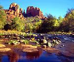 USA, Arizona,  Sedona, Cathedral Rock reflecting in Oak Creek.