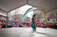 Beautiful Chinese Woman Performs Silk Ribbon Dance at the Lunar New Year Celebration, Chinatown, Seattle, WA, USA.