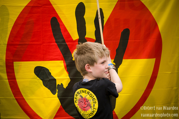 A boy in front of a anti nuclear symbol at an Anti Nuclear Rally held on the Dam Square in Amterdam, the Netherlands on April 16, 2011. Thousands of people gathered on the square to protest recent Netherlands government movements to increase nuclear power in the country.