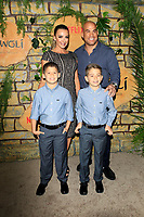 "LOS ANGELES - NOV 28:  Amber Nichole Miller, Tito Ortiz, his sons at the ""Mowgli: Legend of the Jungle"" Premiere at the ArcLight Theater on November 28, 2018 in Los Angeles, CA"