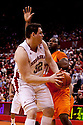 12 February 2011: Nebraska Cornhuskers center Andre Almeida #32 turns to shoot against Oklahoma State Cowboys forward Matt Pilgrim #31 during the first half at the Devaney Sports Center in Lincoln, Nebraska. Nebraska defeated Oklahoma State 65 to 54.