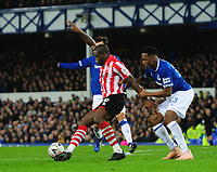 Lincoln City's John Akinde shields the ball from Everton's Yerry Mina<br /> <br /> Photographer Chris Vaughan/CameraSport<br /> <br /> Emirates FA Cup Third Round - Everton v Lincoln City - Saturday 5th January 2019 - Goodison Park - Liverpool<br />  <br /> World Copyright &copy; 2019 CameraSport. All rights reserved. 43 Linden Ave. Countesthorpe. Leicester. England. LE8 5PG - Tel: +44 (0) 116 277 4147 - admin@camerasport.com - www.camerasport.com
