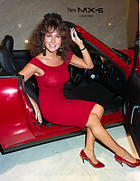 ARCHIVE: LONDON, UK: c. 1988: Page 3 model Linda Lusardi in London at the Motor Show.<br /> File photo © Paul Smith/Featureflash