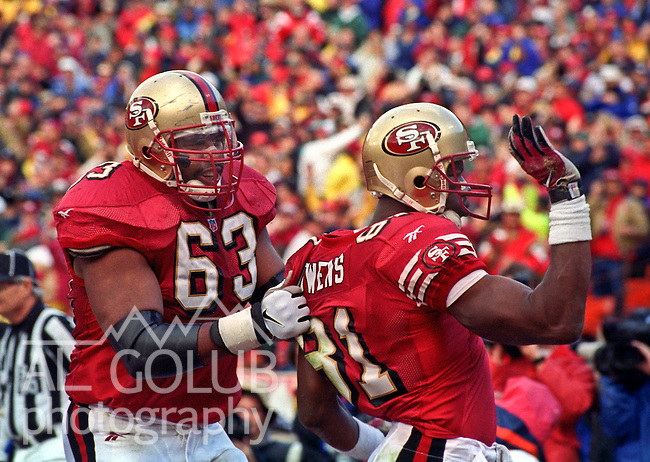 San Francisco 49ers vs. Minnesota Vikings at Candlestick Park Saturday, January 3, 1998.  49ers beat Vikings  38-22.  San Francisco 49ers tackle Derrick Deese (63) celebrate with Terrell Owens (81).