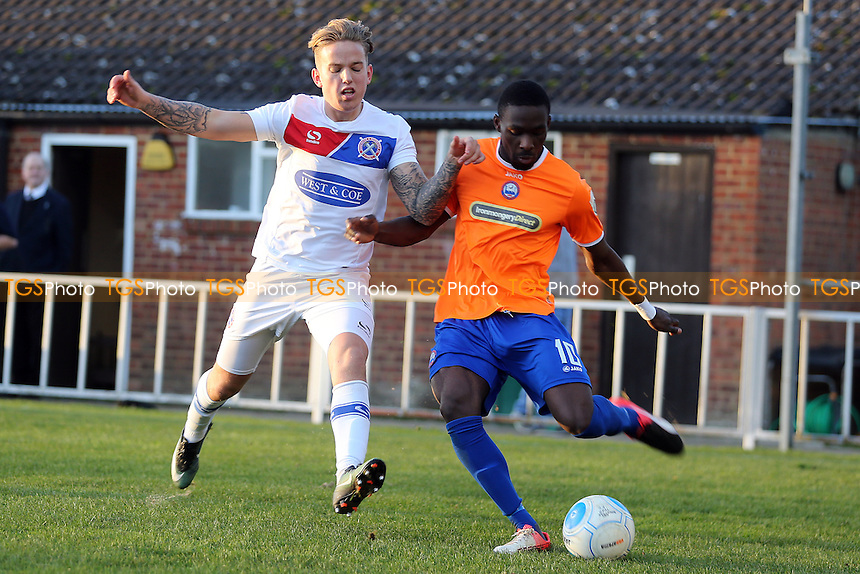 Simeon Akinola of Braintree Town and Jordan Maguire-Drew of Dagenham during Braintree Town vs Dagenham & Redbridge, Vanarama National League Football at the IronmongeryDirect Stadium on 26th December 2016