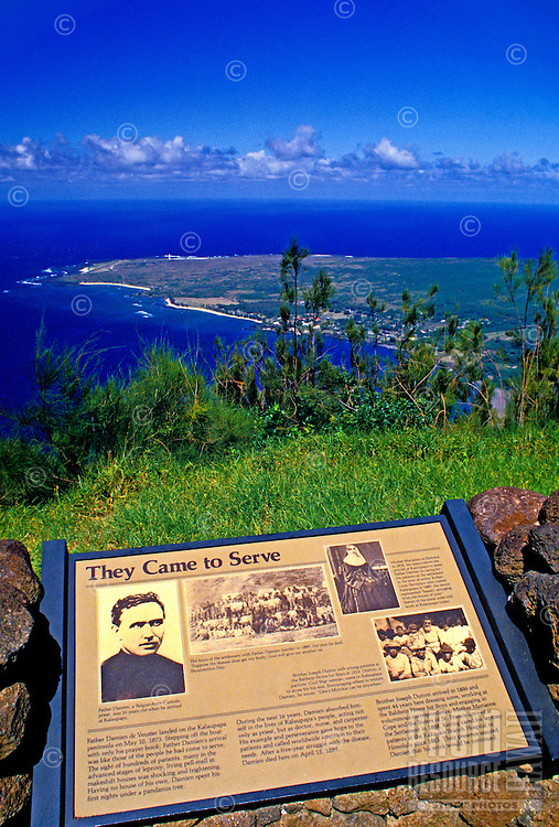 View of Kalaupapa peninsula on Molokai with historic plaque commemorating the missionaries who served the leper colony.