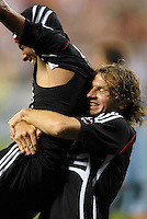 DC United midfielder Fred (7) celebrates his goal in the 82nd minute 82th with teammate Justin Moose (8). DC United defeated Colorado Rapids 4-1, at RFK Stadium in Washington DC, Thursday, June 28, 2007.