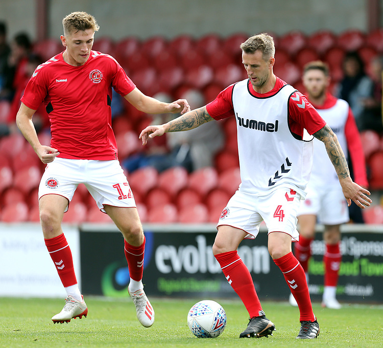 Fleetwood Town's Jimmy Dunne (left) and Peter Clarke players the pre-match warm-up <br /> <br /> Photographer Rich Linley/CameraSport<br /> <br /> The EFL Sky Bet League One - Fleetwood Town v Oxford United - Saturday 7th September 2019 - Highbury Stadium - Fleetwood<br /> <br /> World Copyright © 2019 CameraSport. All rights reserved. 43 Linden Ave. Countesthorpe. Leicester. England. LE8 5PG - Tel: +44 (0) 116 277 4147 - admin@camerasport.com - www.camerasport.com