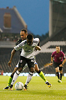 Fulham's Steven Sessegnon shields the ball from Bristol Rovers' Byron Moore during the Carabao Cup match between Fulham and Bristol Rovers at Craven Cottage, London, England on 22 August 2017. Photo by Carlton Myrie.