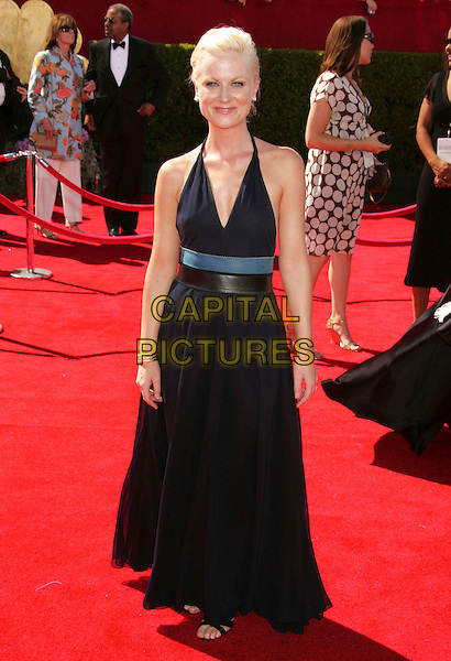AMY POEHLER.58th Annual Primetime Emmy Awards held at the Shrine Auditorium, Los Angeles, California, USA..August 27th, 2006.Ref: ADM/RE.full length black halterneck dress belt.www.capitalpictures.com.sales@capitalpictures.com.©Russ Elliot/AdMedia/Capital Pictures.