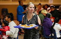 NWA Democrat-Gazette/DAVID GOTTSCHALK  Wendi Campbell, with the Tyson Foods, Inc. Transportation, serves pumpkin pie Tuesday, November 24, 2015, during the Samaritan Community Center  annual Thanksgiving Dinner in Springdale. Seven hundred meals were served in the Springdale location with all of the food provided by the Walmart Transportation Operations, Special Projects and Fixtures Division. Five hundred Blessing Bags, donated items from Walmart ISD containing all of the ingredients for a traditional Thanksgiving Meal, were also distributed during the meal.