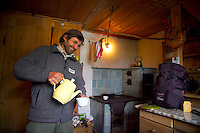 National Park Hohe Tauern, Salzburgerland, Austria, May 2006. Park Ranger Pepi pores a hot tea in the rangers hut. Trekking the alms means lots of good mountain life, wallking and good food. Photo by Frits Meyst/Adventure4ever.com