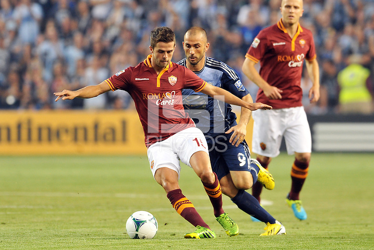 Sporting Park, Kansas City, Kansas, July 31 2013:<br /> Miralem Pjanic (15) midfield AS Roma shields the ball from Marco Di Vaio.<br /> MLS All-Stars were defeated 3-1 by AS Roma at Sporting Park, Kansas City, KS in the 2013 AT &amp; T All-Star game.