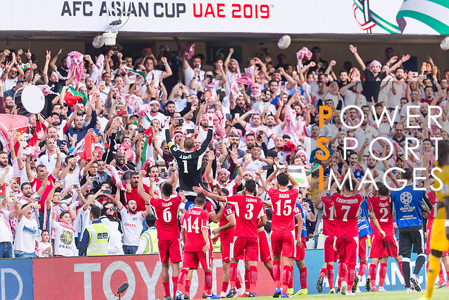 The Jordan team celebrates winning with the supporters after the AFC Asian Cup UAE 2019 Group B match between Australia (AUS) and Jordan (JOR) at Hazza Bin Zayed Stadium on 06 January 2019 in Al Ain, United Arab Emirates. Photo by Marcio Rodrigo Machado / Power Sport Images