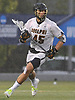 Nick Reisig #45 of Adelphi University carries downfield during a rain-filled first round game against Pace in the NCAA Division II Tournament at Motamed Field in Garden City, NY on Saturday, May 13, 2017.
