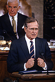 United States President George H.W. Bush speaks to a Joint Session of the U.S. Congress in the U.S. House Chamber in the Capitol in Washington, D.C. to report on the victory over Iraq in the Gulf War on March 6, 1991.  Speaker of the U.S. House Tom Foley (Democrat of Washington) is behind the President..Credit: Arnie Sachs / CNP