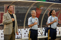 Los Angeles Galaxy head coach Bruce Arena, associate head coach Dave Sarachan, and assistant coach Cobi Jones. The Los Angeles Galaxy defeated the New York Red Bulls 3-1 during a Major League Soccer match at Giants Stadium in East Rutherford, NJ, on July 16, 2009.