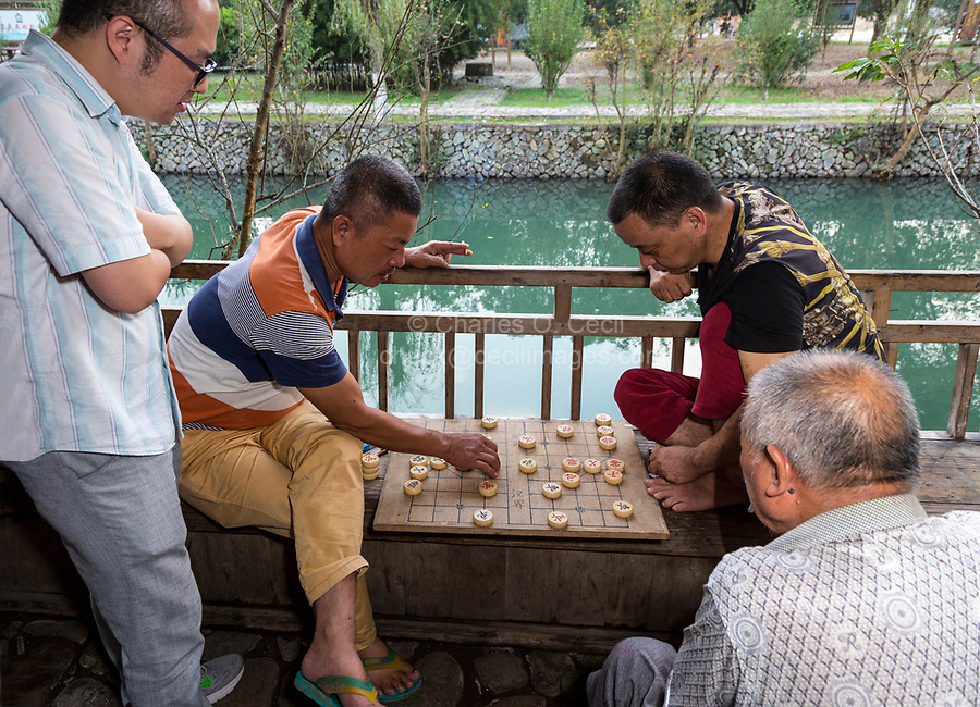 Yantou, Yongjia, Zhejiang, China.  Men Playing Checkers, Lishui Street.