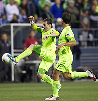 Zach Scott, left, of the Seattle Sounders FC gets control of the ball as teammate Patrick Ianni watches during a CONCACAF Champions League match against CF Monterrey at CenturyLink Field in Seattle Tuesday Oct. 18, 2011. CF Monterrey won the game 2-1.