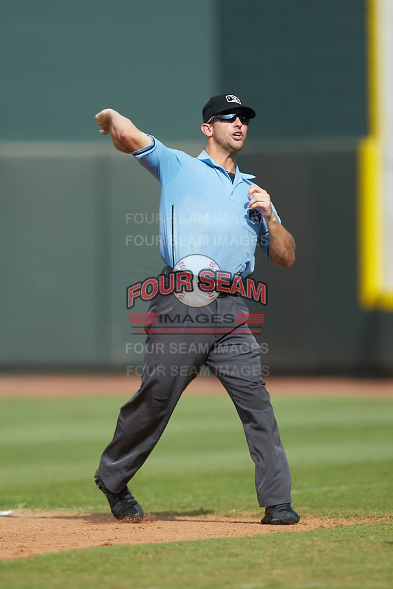 Umpire Jason Johnson ejects Winston-Salem Rayados hitting coach Charlie Poe (not pictured) from the game against the Potomac Nationals at BB&T Ballpark on August 12, 2018 in Winston-Salem, North Carolina. The Rayados defeated the Nationals 6-3. (Brian Westerholt/Four Seam Images)