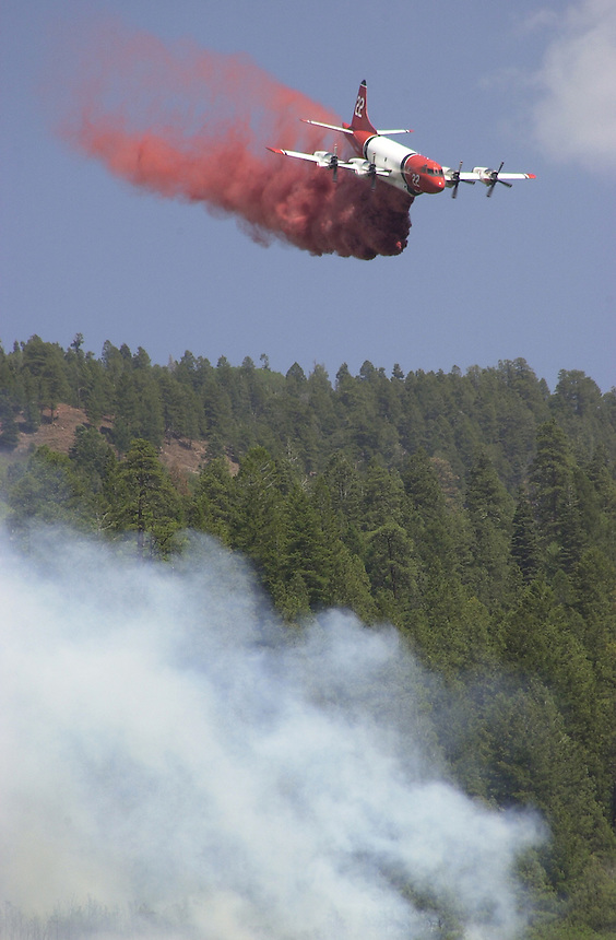 A slurry tanker drops a load of fire retardant on a wildfire shortly after the Missionary Ridge Fire started on June 6, 2002, north of Durango, Colorado.