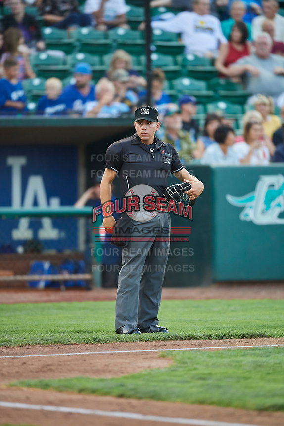 Umpire Rene Gallegos handles the calls behind the plate during a game between the Ogden Raptors and the Billings Mustangs at Lindquist Field on August 18, 2018 in Ogden, Utah. Billings defeated Ogden 6-4. (Stephen Smith/Four Seam Images)