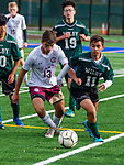 WATERBURY,  CT-101619JS14-  Sacred Heart's Nicholas Turner (13) and  Wilby's Nilton Miguel (11) battle for the ball during their NVL game Thursday at Municipal Stadium in Waterbury. <br />  Jim Shannon Republican-American