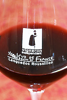 Glass embossed marked with Vigneron Independant (independent wine grower) and Sud de France, South of France, new regional denomination, Languedoc Roussillon. Domaine Bertrand-Berge In Paziols. Fitou. Languedoc. France. Europe.