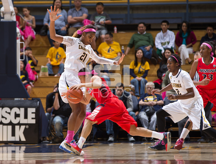 California's Reshanda Gray tries to block Arizona's Candice Warthen during a game at Haas Pavilion in Berkeley, California on February 14th, 2014. California defeated Arizona 65 - 49