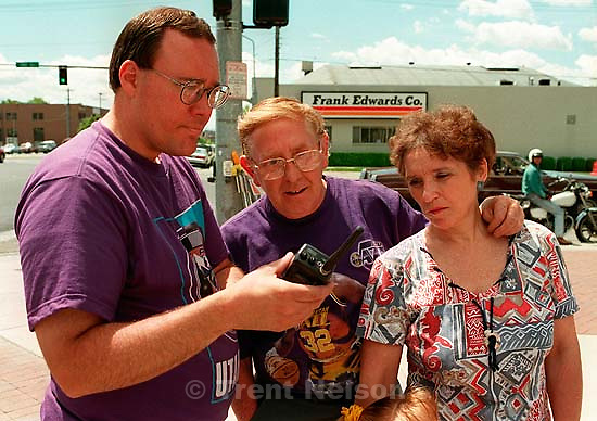 People listen the press conference on a scanner at Apex shoes' promotion when Karl Malone won the NBA MVP award. They had the &quot;world's biggest T-shirt&quot; for fans to sign.<br />