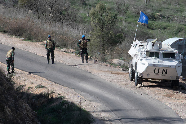 A picture taken on December 5, 2018 shows United Nations Interim Force in Lebanon (UNIFIL) soldiers standing by an armoured personnel carrier (APC) along the Israel-Lebanon border near the northern Israeli town of Misgav Am. - Israel had announced on December 4 that it had discovered Hezbollah tunnels infiltrating its territory from Lebanon and launched an operation to destroy them.  Photo by: Ayal Margolin - JINIPIX