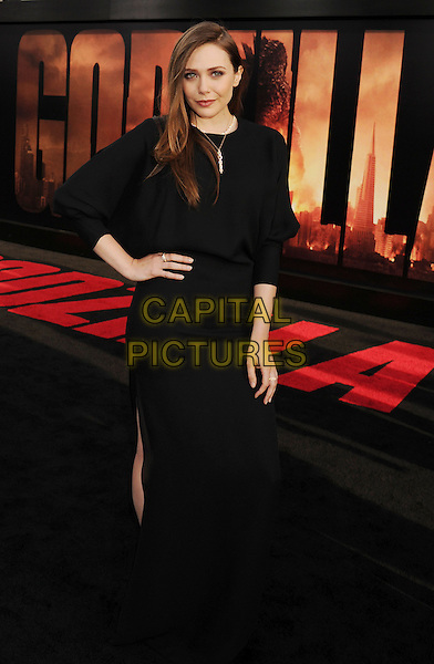 HOLLYWOOD, CA- MAY 08: Actress Elizabeth Olsen arrives at the Los Angeles premiere of 'Godzilla' at Dolby Theatre on May 8, 2014 in Hollywood, California.<br /> CAP/ROT/TM<br /> &copy;Tony Michaels/Roth Stock/Capital Pictures