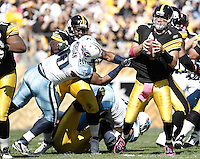 PITTSBURGH, PA - OCTOBER 09:  Ben Roethlisberger #7 of the Pittsburgh Steelers attempts to evade a tackle by Derrick Morgan #90 of the Tennessee Titans during the game on October 9, 2011 at Heinz Field in Pittsburgh, Pennsylvania.  (Photo by Jared Wickerham/Getty Images)