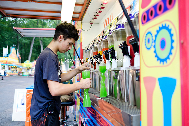 Wolcott, CT-18 August 2017-081817CM02-  Ryan Rockhill 16 of Wolcott makes a slushy during the Wolcott Country Fair on Friday.  The fair continues Saturday and Sunday with gates opening at 10 a.m. and closing at 10 p.m.      Christopher Massa Republican-American