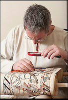BNPS.co.uk (01202 558833).Pic: PeterWillows/BNPS..A Normans Conquest.....Andy at work...Norman nut Andy Wilkinson has spent an astonishing 18 year's sewing a 40ft long copy of the Bayeux Tapestry...Despite not having picked up a needle and thread before, Andy, a member of a historical reenactment group, started the project as a way of decorating his Norman tent during long wet weekends at festivals...But the increasingly large strip of embroidery soon outgrew Andy's tent, and the engineer from Chatham is now hoping the Battle Abbey museum near Hastings will display his amazing work...Andy, 51, has spent more than 10,000 hours sewing the tapestry, that is now longer than a tennis court and is just under a foot high...It is a 2:1 scale version of the actual embroidery that is exhibited in the Normandy town of Bayeux.