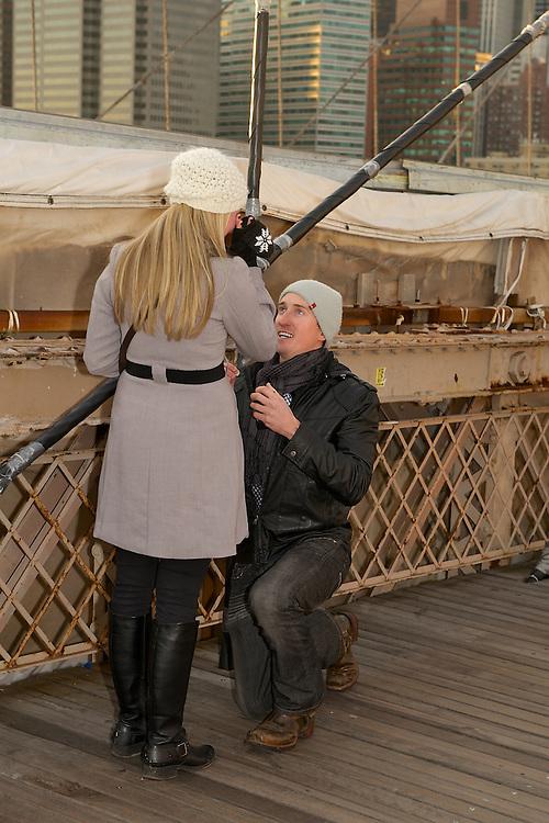 Brooklyn Bridge wedding proposal-  on his knees proposing.