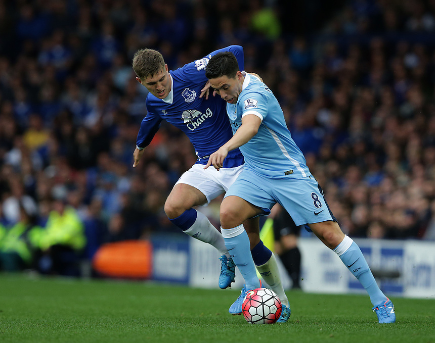 Manchester City's Samir Nasri battles with Everton's John Stones<br /> <br /> Photographer Stephen White/CameraSport<br /> <br /> Football - Barclays Premiership - Everton v Manchester City - Sunday 23rd August 2015 - Goodison Park - Liverpool<br /> <br /> &copy; CameraSport - 43 Linden Ave. Countesthorpe. Leicester. England. LE8 5PG - Tel: +44 (0) 116 277 4147 - admin@camerasport.com - www.camerasport.com