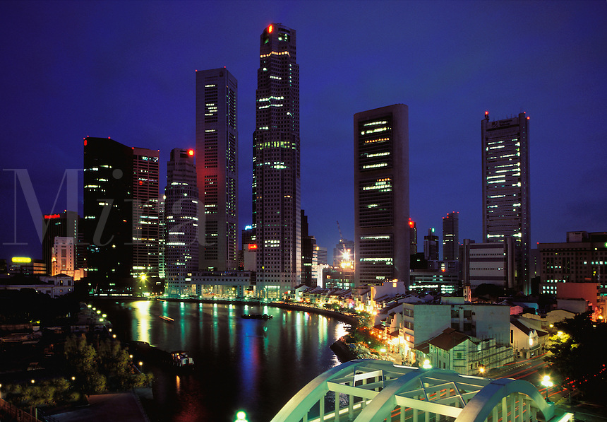 Singapore. Boat Quay and the financial center/centre. Evening.