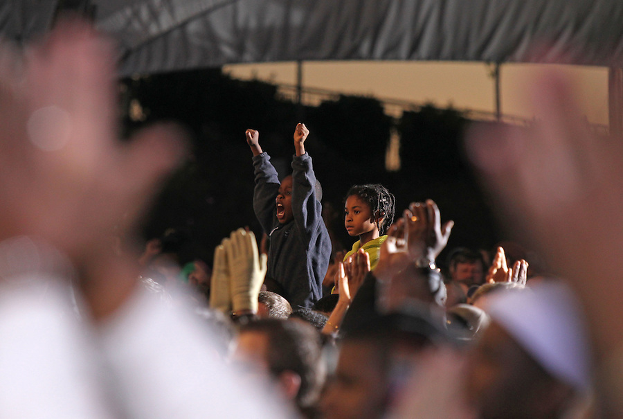 Oct 29, 2010. Members of the a capacity crowd cheer for with President Barack Obama during the campaign rally for Virginia 5th District Representative Congressman Tom Perriello Friday at the Charlottesville Pavilion in downtown Charlottesville, Va. Photo/Andrew Shurtleff